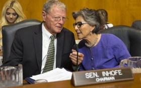 Senate Environment and Public Works Committee Chairman Sen. Jim Inhofe, R-Okla., left, talks with the committee's ranking member Sen. Barbara Boxer, D-Calif., on Capitol Hill in Washington, Wednesday, Sept. 16, 2015, before the start of the committee's hearing with Environmental Protection Agency (EPA) Administrator Gina McCarthy on the Gold King Mine wastewater spill. (AP Photo/Evan Vucci)
