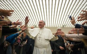Pope Francis is cheered upon his arrival for the weekly general audience in the Pope Paul VI hall at the Vatican on Feb. 4.(Photo: AP)