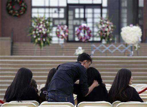 Friends of Yvette Velasco arrive for a memorial services on Thursday, Dec. 10, 2015 in Covina, Calif. Velasco died in a mass shooting in San Bernardino, Calif. last Wednesday. (AP Photo/Jae C. Hong)