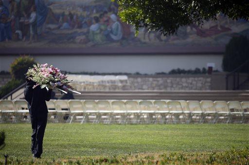 Flowers are delivered for a memorial service for Yvette Velasco, 27, on Thursday, Dec. 10, 2015 in Covina, Calif. Velasco died in a mass shooting in San Bernardino, Calif., last Wednesday. (AP Photo/Jae C. Hong)