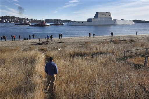 The first Zumwalt-class destroyer, the USS Zumwalt, the largest ever built for the U.S. Navy, leaves the Kennebec River, Monday, Dec. 7, 2015, in Phippsburg, Maine. The ship is headed out to sea for the first time to undergo sea trials. (AP Photo/Robert F. Bukaty)