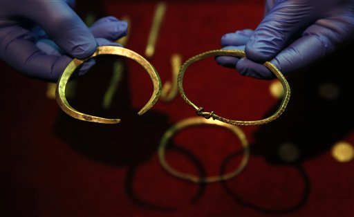 A close up of some of the jewellery and ingots of a significant Viking Hoard found near Watlington, in Oxfordshire, England as they are displayed at the British Museum in London, Thursday, Dec. 10, 2015. The hoard  contains 186 coins, seven items of jewellery and 15 ingots of precious metal. The items include rare coins from era of King Alfred the Great (871-899) and King Ceolwulf II (874-79) when the kingdoms of Mercia and Wessex  fought the invading 'Great Heathen Army' also known as the great Danish army, in the late 800's.(AP Photo/Alastair Grant)