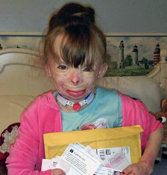 From Safyre Schenectady's Super Survivor, where Safyre is seen holding recent cards mailed from strangers.