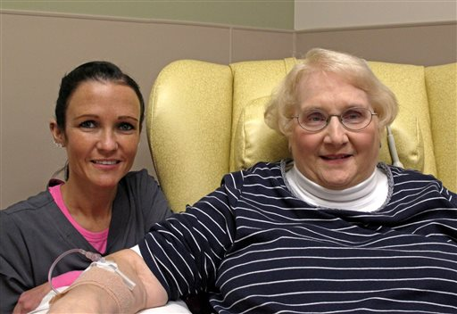In this Dec. 22, 2015 photo, nurse Nicole Krahn, left, poses with near semi-retired nurse Lynn Bartos  (AP Photo/Carrie Antlfinger)