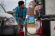 In this Wednesday, Nov. 25, 2015, photo, Cornelio Bonilla pumps gas at Best Food Mart gas station in Gainesville Ga. The price of oil continues to fall, extending a slide that has already gone further and lasted longer than most thought, and probing depths not seen since 2003. (AP Photo/Kevin Liles)