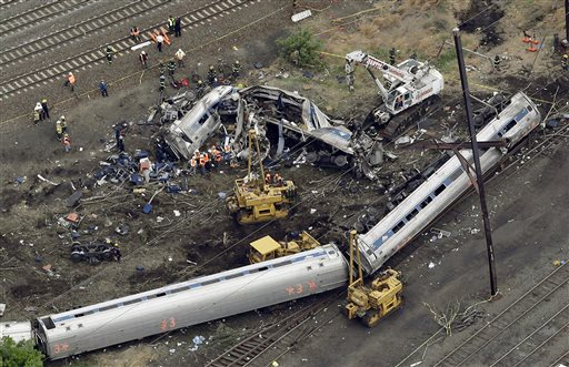 FILE - In this May 13, 2015 file photo, emergency personnel work at the scene of a derailment in Philadelphia of an Amtrak train headed to New York. A federal accident investigations board is set to release documents Feb. 1, 2016, that could shed light on the cause of a fatal Amtrak train derailment in Philadelphia last year. The National Transportation Safety Board has wrapped up its investigative phase into the crash that killed eight people and injured about 200 others. The board is now releasing factual information gathered so far. (AP Photo/Patrick Semansky, File)