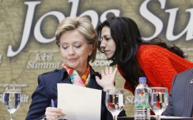 Democratic presidential hopeful, Sen. Hillary Rodham Clinton, D-N.Y., left, has a word with aide Huma Abedin prior to the start of a discussion on jobs, Wednesday, April 2, 2008, during a campaign event at the IBEW Local Union 5 Training Facility in Pittsburgh, Pa. (AP Photo/Charles Dharapak)