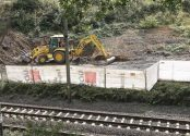 """FILE - In this Aug. 16, 2016 file picture heavy machinery begins the search, the work of explorers hoping to find a legendary Nazi train laden with treasure and armaments in Walbrzych, Poland.  Explorers' great hopes for finding a legendary Nazi """"gold train"""" in Poland appeared dashed Wednesday Aug. 24, 2016, when, after digging extensively, they admitted they have found """"no train, no tunnel"""" at the site.  (AP Photo/Dariusz Gdesz,file)"""