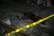 """EDS: NOTE GRAPHIC CONTENT - The body of one of the three suspects killed in an alleged """"buy-bust"""" operation by the authorities in the continuing """"War on Drugs"""" campaign of Philippine President Rodrigo Duterte lies on the ground by the railroad tracks before dawn Friday, Sept. 30, 2016 in Caloocan city, north of Manila, Philippines. Duterte raised the rhetoric over his bloody anti-crime war to a new level Friday, comparing it to Hitler and the Holocaust and saying he would be """"happy to slaughter"""" 3 million addicts. (AP Photo/Bullit Marquez)"""