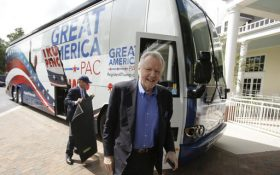 In this Monday, Sept. 12, 2016 photo, conservative actor and Donald Trump supporter Jon Voight arrives on the Great America PAC bus for a town hall meeting in Lake Mary, Fla. The Great America PAC is rolling through battleground states, opening offices and registering voters. Presidential hopefuls often embark on bus tours to meet voters across the country. This time, a super PAC is standing in for Republican nominee Donald Trump. (AP Photo/John Raoux)