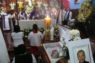 This Sept. 21, 2016 photo shows the funeral Mass for slain Rev. Jose Alfredo Suarez de la Cruz at Our Lady of Asuncion Church in Paso Blanco, Veracruz state, Mexico, his hometown. Church leaders are increasingly frustrated by authorities' inability to protect their priests under Mexican President Enrique Pena Nieto's administration. (AP Photo/Marco Ugarte)