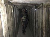 A soldier with Iraq's elite counterterrorism force inspects a tunnel made by Islamic State militants in Bartella, Iraq, Thursday, Oct. 27, 2016. The town of Bartella in northern Iraq lays about 20 kilometres east of Mosul. (AP Photo/Ali Abdul Hassan)