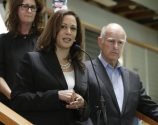 FILE - In this May 23, 2016 file photo, Attorney General Kamala Harris appears with California Gov. Jerry Brown, right, during a news conference in Sacramento, Calif. Harris announced she has launched a criminal investigation into the sales practices of Wells Fargo, on Wednesday, Oct. 19, 2016.(AP Photo/Rich Pedroncelli, File)
