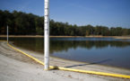 In this Wednesday, Oct. 26, 2016 photo, a floating swim line lays on the shore as Lake Lanier water levels stand about eight feet below normal in Buford, Ga. Some of the South's most beautiful mountains and valleys this fall are filled with desperation, as a worsening drought kills crops, threatens cattle and sinks lakes to their lowest levels in years. (AP Photo/David Goldman)