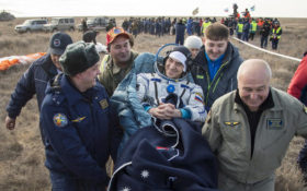 In this photo released by NASA, Russian cosmonaut Anatoly Ivanishin of Roscosmos is carried to a medical tent shortly after he is helped out of the Soyuz MS-01 spacecraft along with astronaut Kate Rubins and astronaut Takuya Onishi of the Japan Aerospace Exploration Agency (JAXA) who landed in a remote area near the town of Zhezkazgan, Kazakhstan Sunday, Oct. 30, 2016. The Russian Soyuz space capsule has landed in Kazakhstan, bringing back three astronauts from the United States, Japan and Russia back to Earth from a 115-day mission aboard the International Space Station. (Bill Ingalls/NASA via AP)