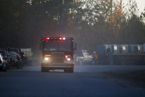 A fire truck drives on River Road near the scene of an explosion of a Colonial Pipeline, Monday, Oct. 31, 2016, in Helena, Ala. Colonial Pipeline said in a statement that it has shut down its main pipeline in Alabama after the explosion in a rural part of the state outside Birmingham. (AP Photo/Brynn Anderson)