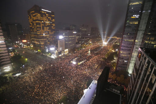 In this Saturday, Nov. 5, 2016 photo, South Korean protesters stage a rally calling for South Korean President Park Geun-hye to step down in downtown Seoul, South Korea. South Korea is seeing its biggest wave of street demonstrations in decades but nobody is sure how many people are taking to the streets each week. At first media relied on two sources - the police and the organizer. But they have been accused of underestimating or overestimating the crowds in the previous four Saturdays (AP Photo/Ahn Young-joon, File)