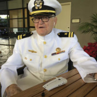 In this Monday, Dec. 5, 2016 photo, Jim Downing, wearing a Navy uniform, answers questions during an interview in Honolulu. Downing is among a few dozen survivors of the Japanese attack on Pearl Harbor who plan to gather at the Hawaii naval base, Wednesday, Dec. 7, 2016, to remember those killed 75 years ago. Thousands of servicemen and women and members of the public are also expected to attend the ceremony. (AP Photo/Audrey McAvoy)