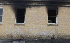 """FILE-In this Wednesday, Nov. 2, 2016 file photo, """"Vote Trump"""" is spray painted on the side of the fire damaged Hopewell M.B. Baptist Church in Greenville, Miss. Mississippi authorities arrested a McClinton Wednesday in the burning of an African-American church that was also spray-painted with the words, """"Vote Trump."""" (AP Photo/Rogelio V. Solis, File)"""