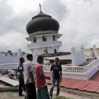 Men inspect a collapsed mosque after an earthquake in Pidie Jaya, Aceh province, Indonesia, Wednesday, Dec. 7, 2016. A strong undersea earthquake rocked Indonesia's Aceh province early on Wednesday, killing a number of people and causing dozens of buildings to collapse. (AP Photo/Heri Juanda)